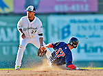 30 June 2012: Vermont Lake Monsters infielder Wilfredo Solano is unable to get a sliding Mike Miller out at second during a game against the Lowell Spinners at Centennial Field in Burlington, Vermont. Mandatory Credit: Ed Wolfstein Photo