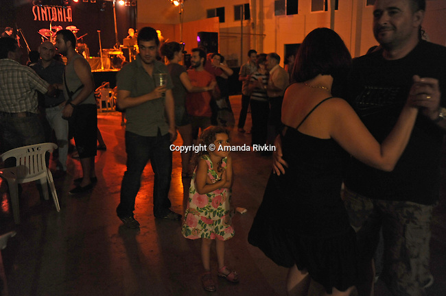 Couples dance late into the night during the municipal fiestas in Costur, Spain on August 15, 2009.