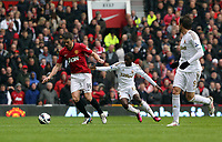 Pictured: (L-R) Michael Carrick, Nathan Dyer, Michu.<br /> Sunday 12 May 2013<br /> Re: Barclay's Premier League, Manchester City FC v Swansea City FC at the Old Trafford Stadium, Manchester.
