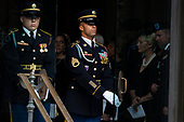 Cindy and Jimmy McCain, right, the wife and son of late United States Senator John McCain (Republican of Arizona) look on as a Military Honor Guard carries the Senator's casket out of the Cathedral following a funeral for the late Senator at the Washington National Cathedral in Washington, DC on September 1, 2018. <br /> Credit: Alex Edelman / CNP