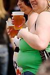Two fat women drinking beer. Cambridgeshire UK 2008.