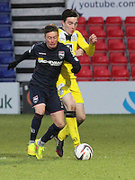 Sean Kelly tackles Joseph Cardle in the Ross County v St Mirren Scottish Professional Football League match played at the Global Energy Stadium, Dingwall on 17.1.15.