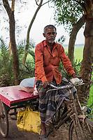 Bangladesh, Jhenaidah. Man driving cart.