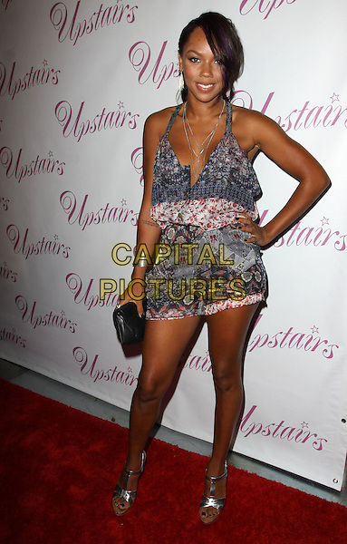 KIELY WILLIAMS .Grand Opening of Upstairs Boutique held At Upstairs Boutique, West Hollywood, California, USA..July 30th, 2009.full length grey gray white red pattern playsuit halterneck hand on hip clutch bag black .CAP/ADM/KB.©Kevan Brooks/AdMedia/Capital Pictures.