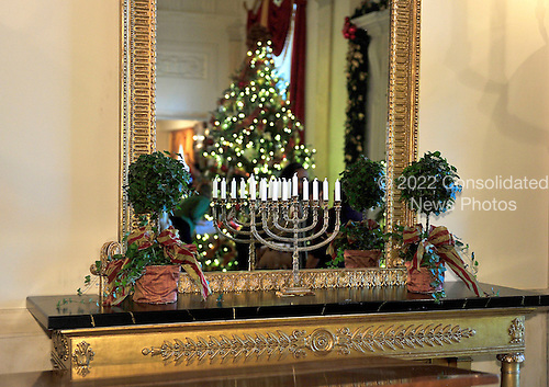 Hanukkah menorah on a table in the Grand Foyer of the White House that is part of the 2012 White House Christmas decorations in Washington, DC on Wednesday, November 28, 2012..Credit: Ron Sachs / CNP