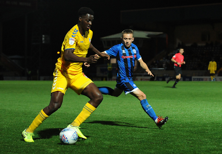 Bolton Wanderers' Josh Emmanuel under pressure from Rochdale's Lewis Bradley<br /> <br /> Photographer Kevin Barnes/CameraSport<br /> <br /> EFL Leasing.com Trophy - Northern Section - Group F - Rochdale v Bolton Wanderers - Tuesday 1st October 2019  - University of Bolton Stadium - Bolton<br />  <br /> World Copyright © 2018 CameraSport. All rights reserved. 43 Linden Ave. Countesthorpe. Leicester. England. LE8 5PG - Tel: +44 (0) 116 277 4147 - admin@camerasport.com - www.camerasport.com