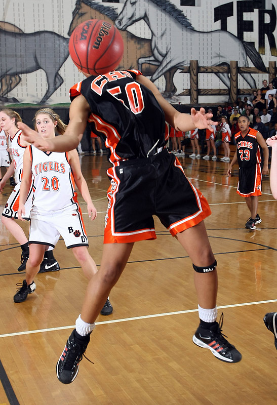 Charlottesville Shalita Brown reaches for the rebound against Brentsville. Photo/Andrew