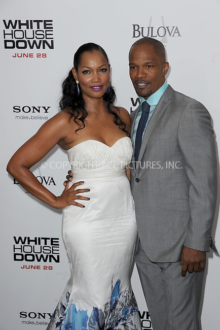 WWW.ACEPIXS.COM<br /> June 25, 2013...New York City <br /> <br /> Garcelle Beauvais-Nilon and Jamie Foxx attending 'White House Down' New York Premiere at Ziegfeld Theater on June 25, 2013 in New York City.<br /> <br /> Please byline: Kristin Callahan... ACE<br /> Ace Pictures, Inc: ..tel: (212) 243 8787 or (646) 769 0430..e-mail: info@acepixs.com..web: http://www.acepixs.com