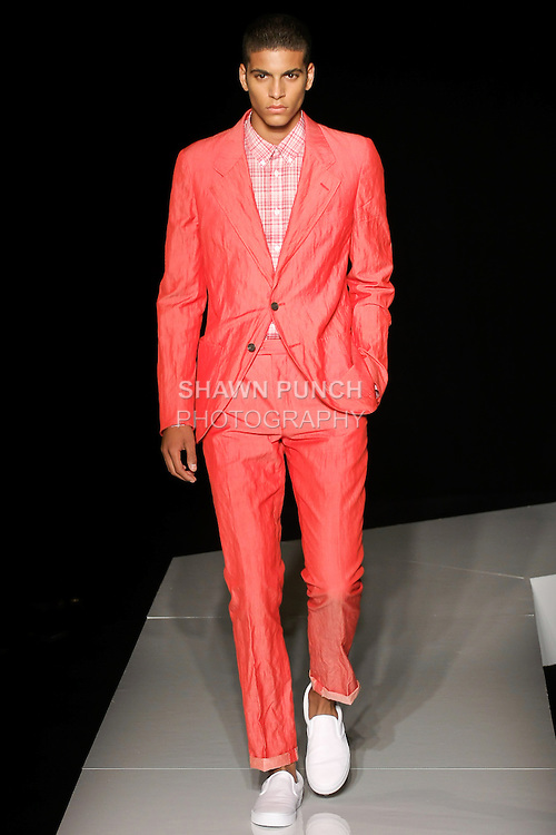 Zakaria walks runway in a red cotton/mohair two button notch unconstructed suit, and red and ivory cotton plaid sports shirt, from the Joseph Abboud Spring Summer 2013 fashion show, during New York Fashion Week Spring 2013.