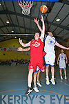 St Mary's Andrew Fitzgerald gets his shot in despite Paul Freeman Titans challenge during their clash in the Premier Men's Final at the St Mary's Basketball Blitz final in Castleisland on Friday night