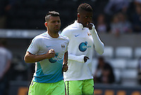 Sergio Aguero and Kelechi Iheanacho of Manchester City warm up during the Barclays Premier League match between Swansea City and Manchester City played at The Liberty Stadium, Swansea on 15th May 2016