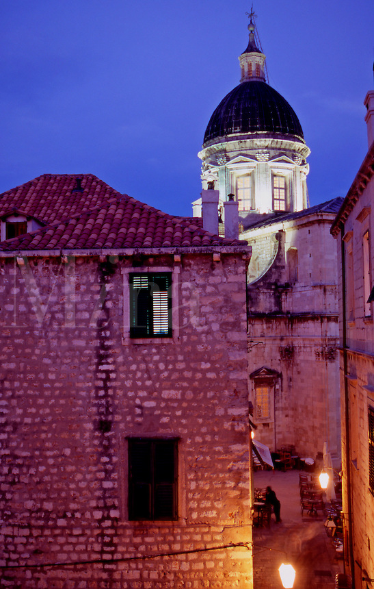 Illuminated alleyway and Cathedral Dome at night..Dubrovnik Old Town. Croatia