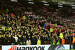 United fans sing on the opposite side of the segregation during the Liverpool fans rendition of You'll Never Walk Alone during the UEFA Europa League match at Anfield. Photo credit should read: Philip Oldham/Sportimage