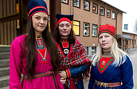 Sámi textile students Tilde-Ristin Kuoljok, Angelica Hedberg, and Anna Erika Svakko wear their traditional gákti from Jokkmokk, Gällivare, and Klimpfjäll respectively.
