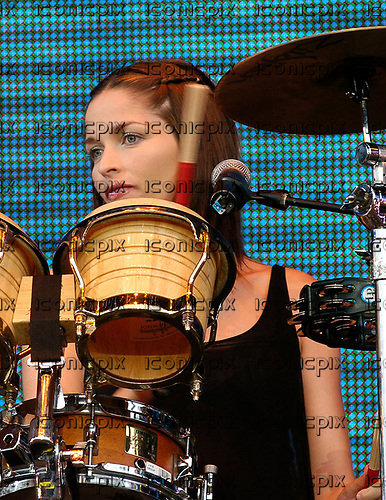 The Corrs - Caroline Corr - performing live at Capital FM's Party  in the Park in Hyde Park London UK - 11 Jul 2004.  Photo credit: George Chin/IconicPix