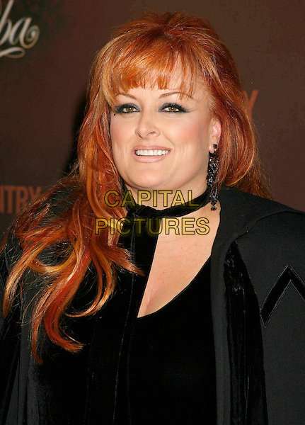 "WYNONNA JUDD.Arrivals at ""CMT Giants"" Honoring Reba McEntire held at the Kodak Theatre, Hollywood, LA, California, USA,.26 October 2006..portrait headshot black top cape.Ref: ADM/RE.www.capitalpictures.com.sales@capitalpictures.com.©Russ Elliot/AdMedia/Capital Pictures."