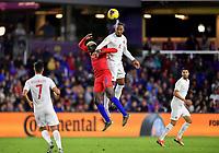 ORLANDO, FL - NOVEMBER 15: Derek Cornelius #4 of Canada leaps high over Gyasi Zardes #9 of the United States during a game between Canada and USMNT at Exploria Stadium on November 15, 2019 in Orlando, Florida.