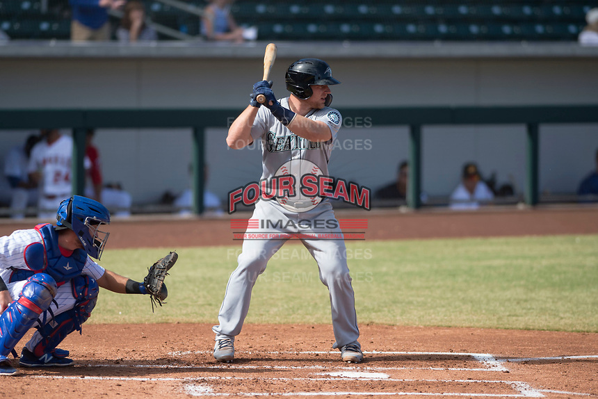 Peoria Javelinas catcher Joe DeCarlo (4), of the Seattle Mariners organization, at bat in front of catcher P.J. Higgins (12) during an Arizona Fall League game against the Mesa Solar Sox at Sloan Park on October 24, 2018 in Mesa, Arizona. Mesa defeated Peoria 4-3. (Zachary Lucy/Four Seam Images)