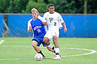 2 October 2011:  FIU forward Colby Burdette (2) passes the ball while being pursued by Kentucky midfielder C.J. Tappel (16) in the first half as the FIU Golden Panthers defeated the University of Kentucky Wildcats, 1-0 in overtime, at University Park Stadium in Miami, Florida.