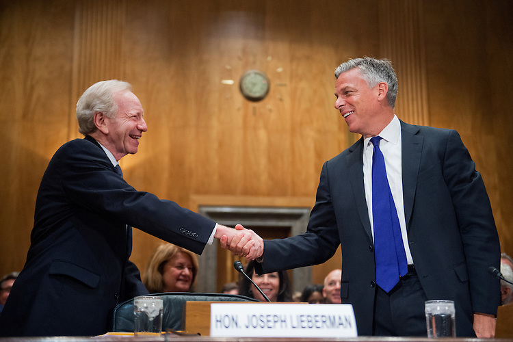 """UNITED STATES - JUNE 17: Former Sen. Joseph Lieberman, I-Conn., left, and former Gov. Jon Huntsman Jr., R-Utah, co-chairs of No Labels, arrive for a Senate Homeland Security and Governmental Affairs Committee hearing in Dirksen Building titled """"Governing Through Goal Setting: Enhancing the Economic and National Security of America,"""" June 17, 2015. (Photo By Tom Williams/CQ Roll Call)"""