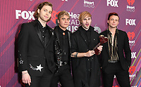 14 March 2019 - Los Angeles, California - 5 Seconds of Summer. 2019 iHeart Radio Music Awards - Press Room held at Microsoft Theater. Photo Credit: Birdie Thompson/AdMedia