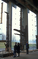 Tourists looking at totem poles in the Great Hall of the Museum of Anthropology on the campus of the University of British Columbia, Vancouver, Canada