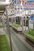 A train of the Nagoya City Subway company on the Meijo (Purple) Line at Nagoya Port Station.