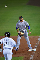 Salt River Rafters first baseman Rowdy Tellez (44) waits for a throw as Jake Bauers (21) runs up the base line during an Arizona Fall League game against the Mesa Solar Sox on October 23, 2015 at Sloan Park in Mesa, Arizona.  Salt River defeated Mesa 5-1.  (Mike Janes/Four Seam Images)