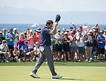 Tony Romo tips his hat to the crowd after winning the American Century Championship at Edgewood Tahoe Golf Course in Stateline, Nevada, Sunday, July 15, 2018.