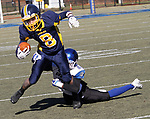 WATERBURY, CT - 23 NOVEMBER 2017 -112317JW06.jpg -- Kennedy High School #8 Evel Pacheco tries to break away from Crosby #2 Jzalic Alexander during the Thanksgiving Day Game at Municipal Stadium.  Jonathan Wilcox Republican-American