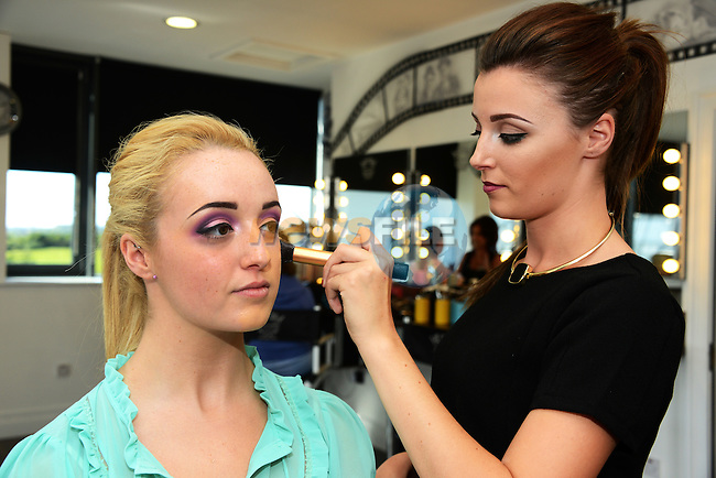Chloe Callan applies makeup for her sister Cherrie at the Avant Garde Make up Academy open day.