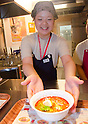 "September 17, 2011 : Yokohama, Japan - Visitors can try 8 kinds of international noodles during the grand opening of the Nissin Cup Noodles Museum. Visitors can learn about the history of the Cup Noodles product and partake in a session to make their own homemade instant ramen noodles at the museum's ""Chikin Noodle Factory"". The museum's art director, Kashiwa Sato, is also in charge of graphic design for the massive Japanese clothes retailer Uniqlo. (Photo by Yumeto Yamazaki/AFLO)"