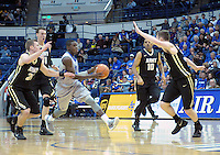December 12, 2015 - Colorado Springs, Colorado, U.S. -  Air Force guard, Trevor Lyons #20, is surrounded by Army Black Knights during an NCAA basketball game between the Army West Point Black Knights and the Air Force Academy Falcons at Clune Arena, U.S. Air Force Academy, Colorado Springs, Colorado.  Army West Point defeats Air Force 90-80.