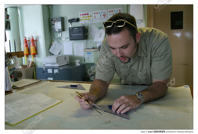 Charting the ship's movements, 3rd Officer Justin Hubbard is a  civilian mariner who mans the ship's operations. (The Merchant Marines, civilians, run the Cmfort, not the Navy). USNS COMFORT Naval hospital ship in the Persian Gulf.