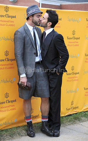Lorenzo Martone and Marc Jacobs at the Second Annual Veuve Clicquot Manhattan Polo Classic on Governors Island at the final event of a two-day visit to New York City. May 30, 2009 Credit: Dennis Van Tine/MediaPunch