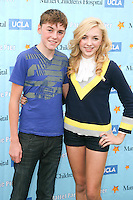 SANTA MONICA, CA - OCTOBER 21:  Spencer List and Peyton List at the Mattel Party On The Pier Benefiting Mattel Children's Hospital UCLA - Red Carpet at Pacific Park at Santa Monica Pier on October 21, 2012 in Santa Monica, California. © mpi20/MediaPunch Inc. /NortePhoto