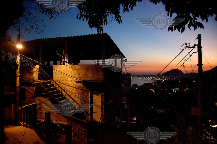 A steet lamp illuminates a building in the Morro da Babilonia favela.