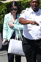 Michelle Trachtenberg escorted by the security - Los Angeles
