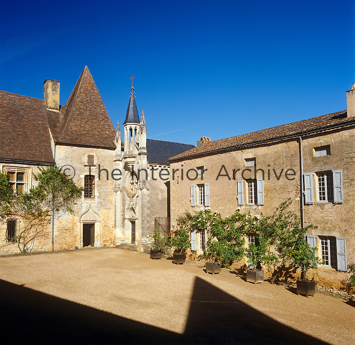The small stone chapel is squeezed between the 17th century chateau and the converted farmhouse