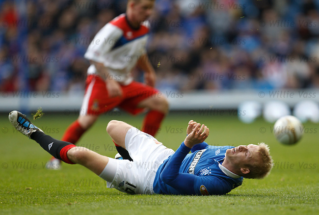 Steven Naismith suffers as Kevin McCann makes a tackle