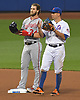Bryce Harper #34, Washington Nationals right fielder, left, stands at second base alongside T.J. Rivera #54 of the New York Mets during a Major League Baseball game at Citi Field in Flushing, NY on Friday, June 16, 2017.
