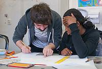 Hearing impaired student listening to her tutor, Art & Design, Kingston College.