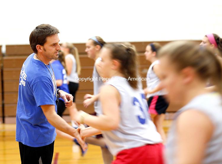 Woodbury, CT- 03 December 2015-120315CM01- Nonnewaug girls head basketball coach Adam Brutting leads his girls during practice in Woodbury on Thursday.      Christopher Massa Republican-American