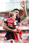 Olivier Giroud of Arsenal with child during the English Premier League match at the Emirates Stadium, London. Picture date: May 21st 2017.Picture credit should read: Charlie Forgham-Bailey/Sportimage