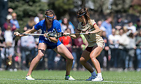 Newton, Massachusetts - April 6, 2019: NCAA Division I. Maintaining an undefeated season, Boston College (white) defeated Duke University (blue), 20-12, at Newton Campus Lacrosse Field.