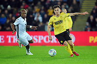 Ben Thompson of Millwall vies for possession with Andre Ayew of Swansea City during the Sky Bet Championship match between Swansea City and Millwall at the Liberty Stadium in Swansea, Wales, UK. Saturday 23rd November 2019