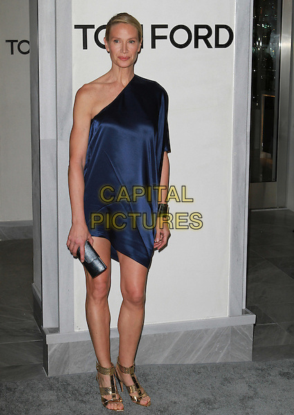 KELLY LYNCH.The Opening of The Tom Ford Beverly Hills Store in Beverly Hills, California, USA..February 24th, 2011.full length blue silk satin one shoulder dress clutch bag gold sandals cuff bracelet .CAP/ADM/KB.©Kevan Brooks/AdMedia/Capital Pictures.