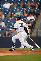 Tampa Yankees right fielder Austin Aune (31) follows through on a swing during a game against the Fort Myers Miracle on April 12, 2017 at George M. Steinbrenner Field in Tampa, Florida.  Tampa defeated Fort Myers 3-2.  (Mike Janes/Four Seam Images)