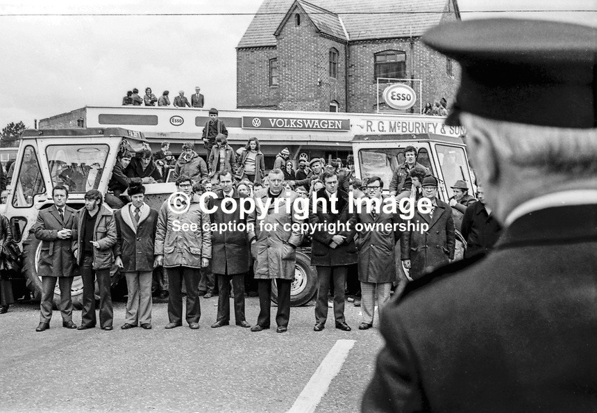 UUAC strike leaders, Rev Ian Paisley and loyalist politician Ernest Baird, join farmers blocking the town centre in Ballymena during the ongoing loyalist strike. The police took no action at the time but later arrested Paisley &amp; Baird and charged them with obstruction. 9th May 1977. 197705090521<br /> <br /> Copyright Image from Victor Patterson, 54 Dorchester Park, <br /> Belfast, UK, BT9 6RJ<br /> <br /> t1: +44 28 9066 1296 (from Rep of Ireland 048 9066 1296)<br /> t2: +44 28 9002 2446 (from Rep of Ireland 048 9002 2446)<br /> m: +44 7802 353836<br /> <br /> e1: victorpatterson@me.com<br /> e2: victorpatterson@gmail.com<br /> <br /> www.victorpatterson.com<br /> <br /> Please see my Terms and Conditions of Use at VICTORPATTERSON.COM. It is IMPORTANT that you familiarise yourself with them.<br /> <br /> Images used on the Internet must be visibly watermarked i.e. &copy;VICTORPATTERSON.COM within the body of the image and copyright metadata must not be deleted. Images used on the Internet have a size restriction of 4kbs and are chargeable at the then current NUJ rates.<br /> <br /> This image is only available for the use of the download recipient i.e. television station, newspaper, magazine, book publisher, etc, and must not be passed on to any third party. It is also downloaded on condition that each and every usage is notified within 7 days to victorpatterson@me.com<br /> <br /> The right of Victor Patterson to be identified as the author is asserted in accordance with The Copyright Designs And Patents Act (1988).