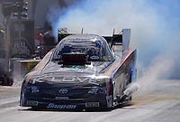 Sept. 14, 2012; Concord, NC, USA: NHRA funny car driver Tony Pedregon during qualifying for the O'Reilly Auto Parts Nationals at zMax Dragway. Mandatory Credit: Mark J. Rebilas-
